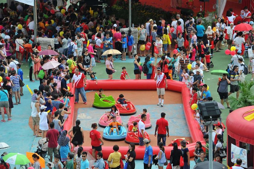 Children on kiddie bumper cars at the Sengkang West Single Member Constituency (SMC)'s 10th Anniversary Carnival Celebrations, at the hardcourt opposite Anchorvale Community Club on July 10, 2016.