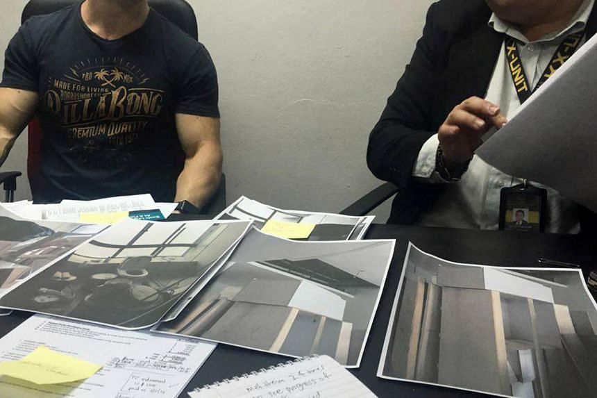 Mr Matthew Allan (left) showing examples of the unfinished work at his new Telok Kurau apartment, at a debt collection agency on July 10, 2016.