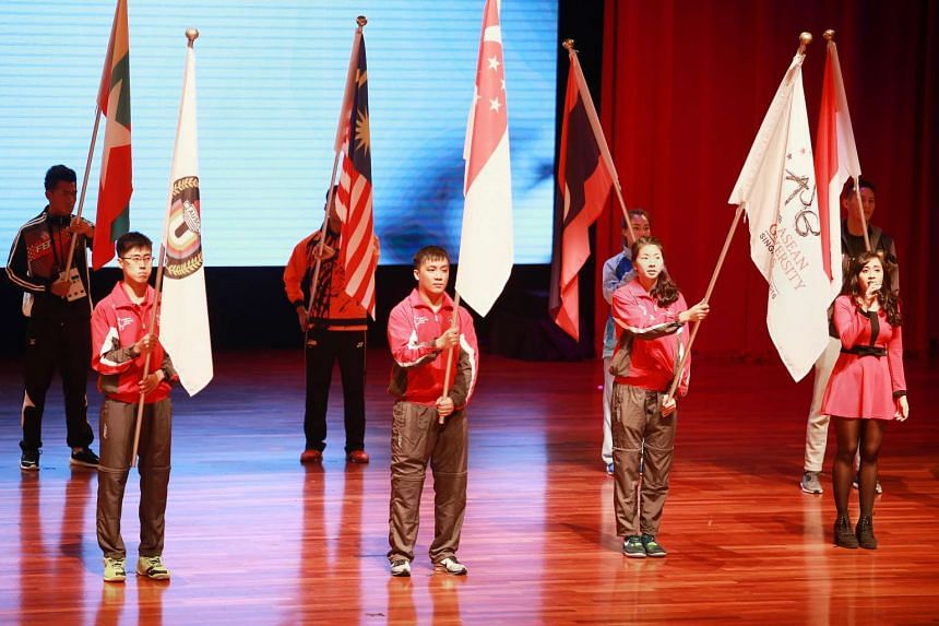 Local paddler Pang Xue Jie (front row, centre) was Singapore's flag bearer for the Asean University Games, which officially opened at Nanyang Technological University on Sunday (July 10).