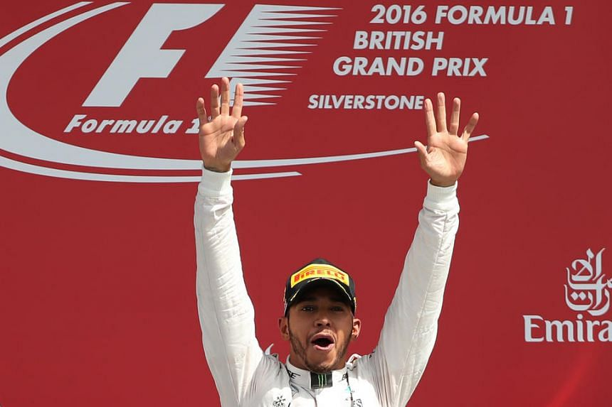 Mercedes' Lewis Hamilton celebrates on the podium after winning the British Grand Prix 2016.