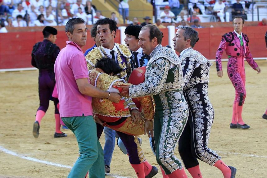 Spanish bullfighter Victor Barrio is carried out from the bullring after being gored during a bullfight held on the occasion of Feria del Angel in Teruel, Spain, on July 9.
