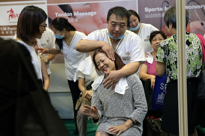 A visitor to the 12th annual Health & You Exhibition getting a free massage yesterday. The two-day health and wellness exhibition, organised by The Straits Times' Mind & Body and Lianhe Zaobao's Lohas, features 80 exhibitors. It runs from 9am to 9pm