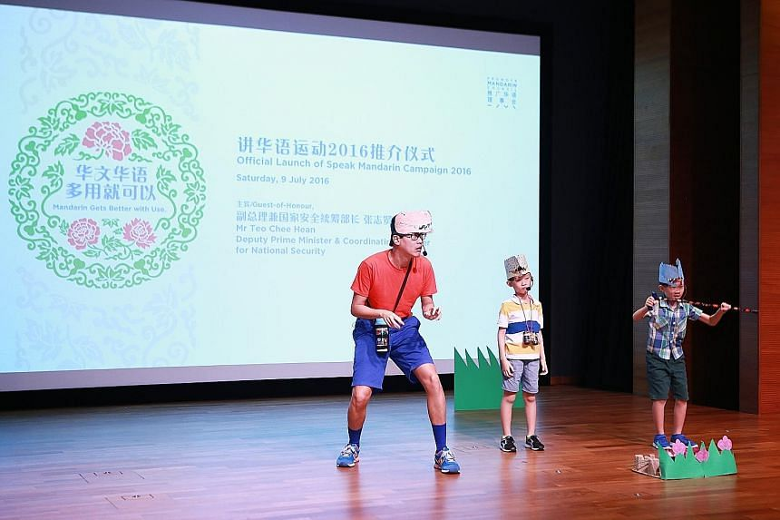 Among previous winners of a talent competition who took the stage yesterday were Mr Chew Kum Lik, 38, an engineering manager, and his two sons Zhen Kai (middle) and Zhen Yuan, both eight.