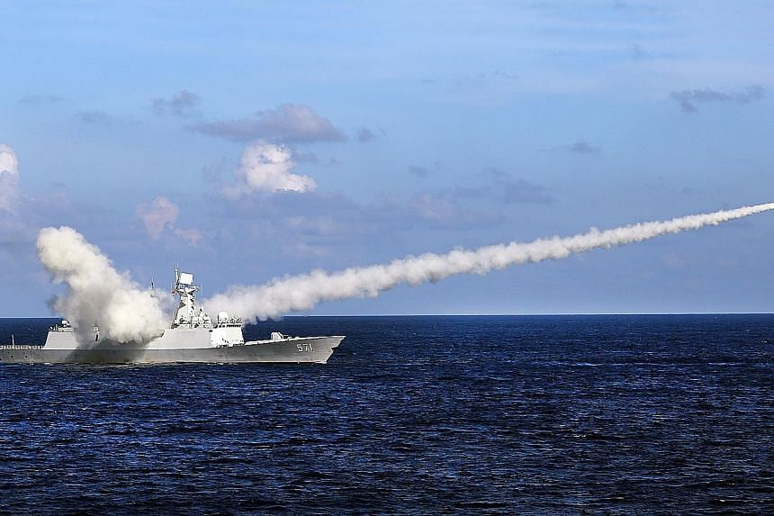 Frigate Yuncheng launching an anti-ship missile on Friday. China is conducting military exercises around the disputed Paracel Islands in the north of the South China Sea that will end tomorrow.