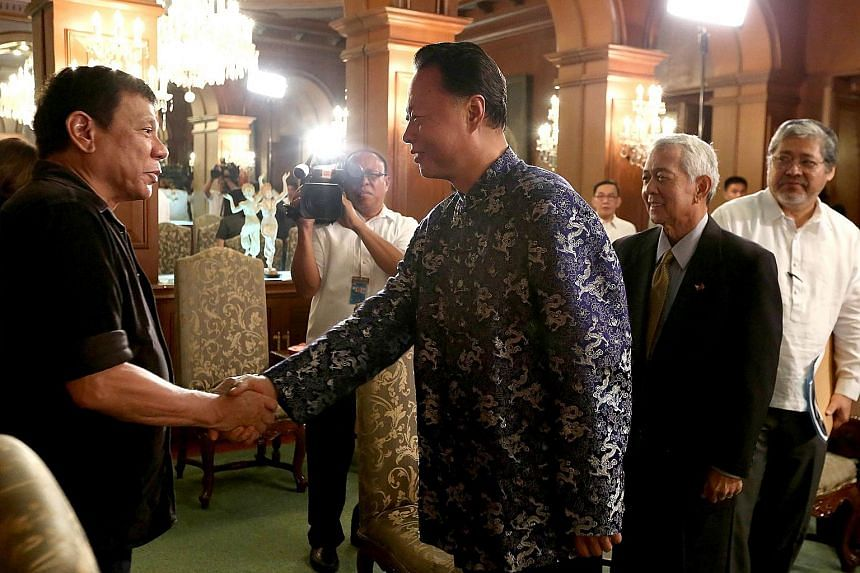 Philippine President Rodrigo Duterte (left) greeting Chinese Ambassador to the Philippines Zhao Jinhua, who made a courtesy call at the Malacanang palace in Manila on Thursday.