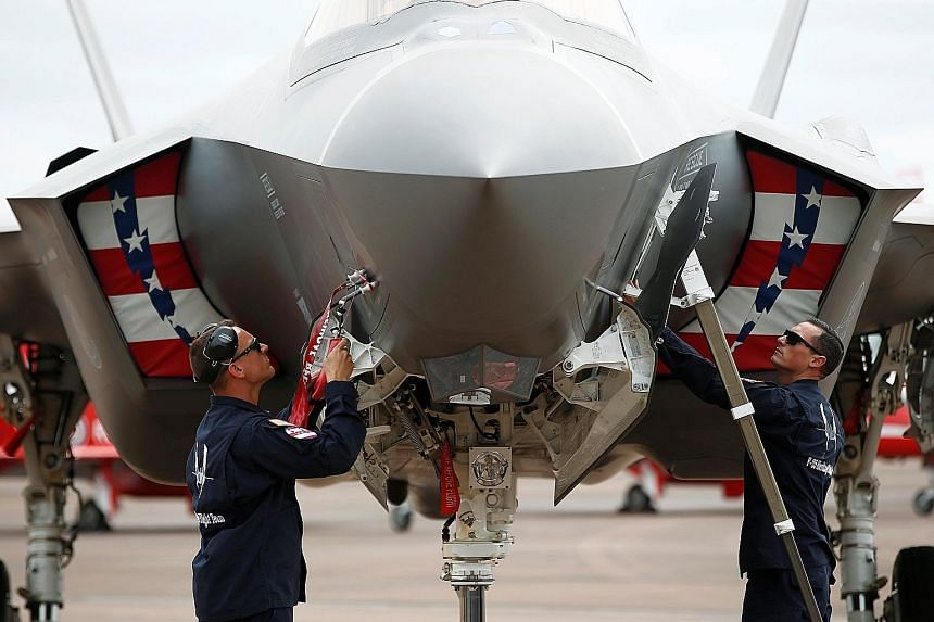 Ground crew working on an F-35A at the Royal International Air Tattoo in Fairford, Britain. The jet was making its first appearance at the world's largest military air show as part of a larger drive to bolster Nato's defences in Europe.
