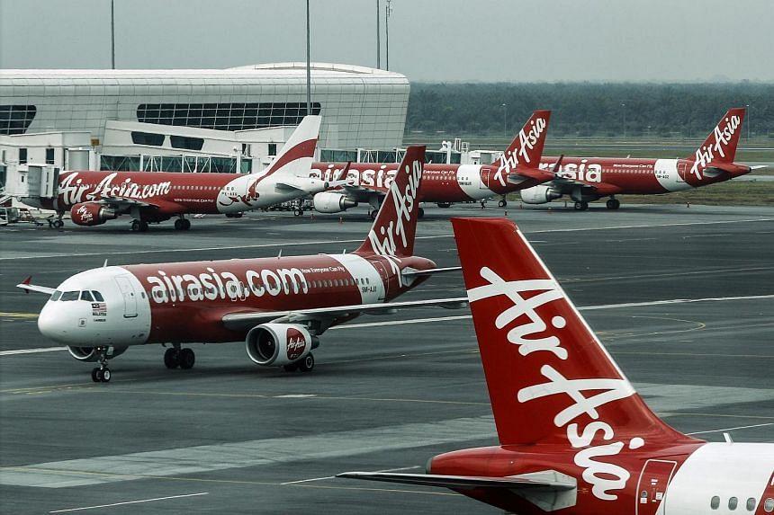 An AirAsia aircraft are seen at Kuala Lumpur International Airport 2 in Sepang near Kuala Lumpur, Malaysia, on July 1.