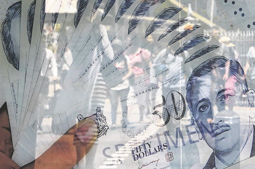 A poster of 50 Singapore dollar bills seen in this file photo taken on April 14. A remittance company has foiled a scam attempt involving $50,000, the third case of its kind in the last two weeks.