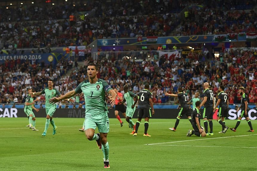 Cristiano Ronaldo celebrates after scoring a goal during the Euro 2016 semi-final football match between Portugal and Wales.