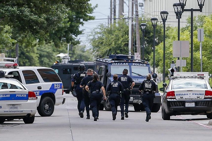 Heavily-armed Dallas Police Department officers investigate a threat at the department's headquarters in Dallas, Texas, US, on July 9.