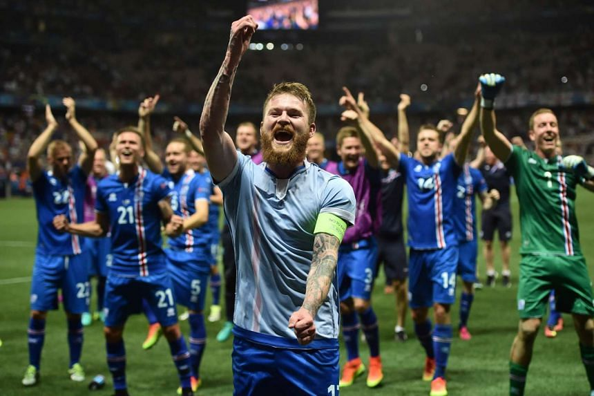 Iceland's Aron Gunnarsson and his teammates celebrating beating England in Nice on June 27, 2016.