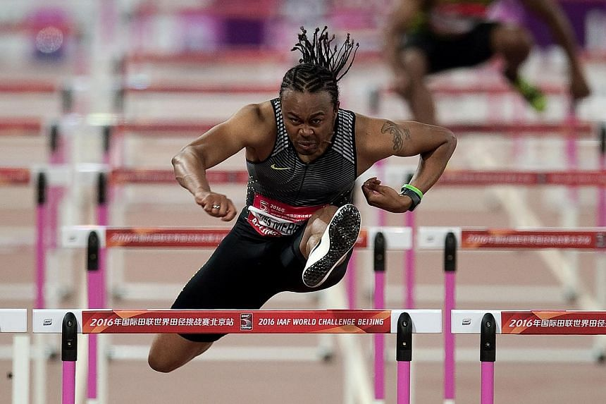 Aries Merritt of the US competes during the men's 110m hurdles final at the IAAF World Challenge at the National Olympic Stadium, known as the Bird's Nest, in Beijing on May 18.