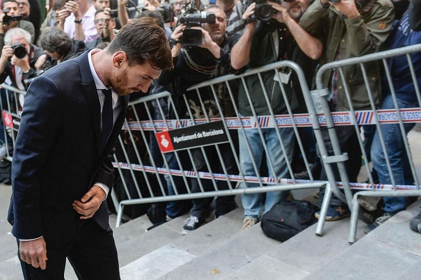 This file photo taken on June 02 shows Barcelona's football star Lionel Messi arriving at the courthouse in Barcelona, where Messi and his father are to face judges in a tax fraud case.