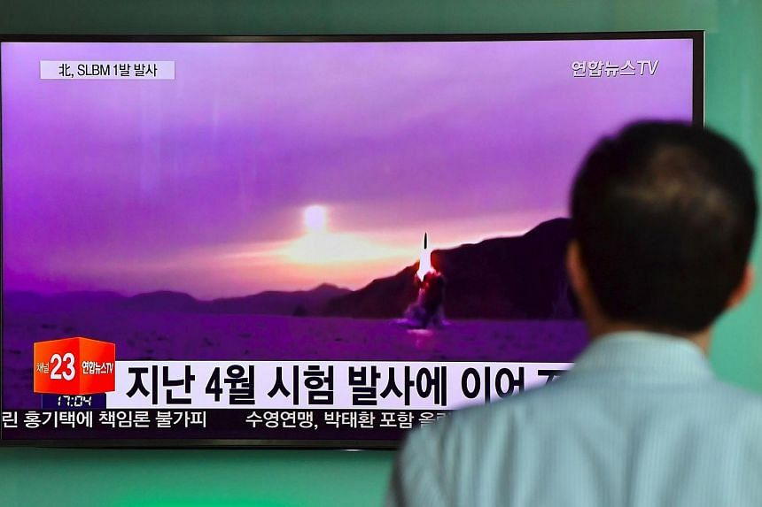 A man watches a television news broadcast in Seoul on July 9 showing file footage of a North Korean missile launch.
