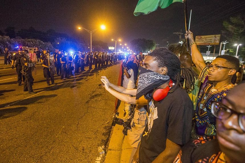 Protesters face off with Baton Rouge police for a second night in a row on July 9, 2016 in Baton Rouge, Louisiana.