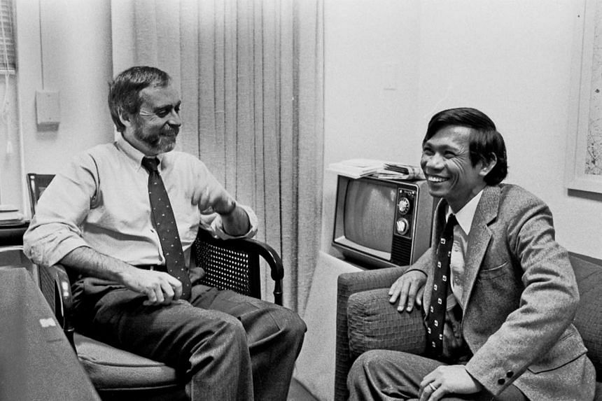 New York Times correspondent Sydney Schanberg (keft) talking with colleague Dith Pran in The Times office in New York on Jan 15, 1980.