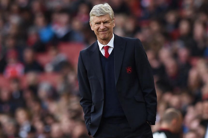 Arsenal manager Arsene Wenger reacts during the Barclays Premier League match between Arsenal and Norwich City on April 30, 2016.
