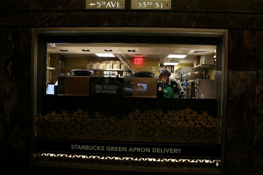 A worker at a Starbucks Green Apron Delivery Service at the Empire State Building in the Manhattan borough of New York, on June 1, 2016.