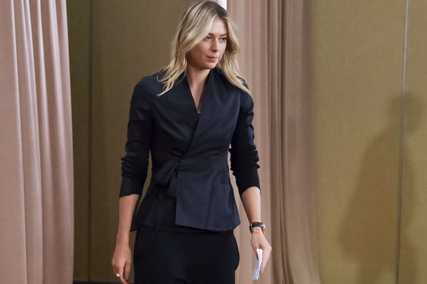 Maria Sharapova arrives for a press conference in Los Angeles, on March 7, 2016.
