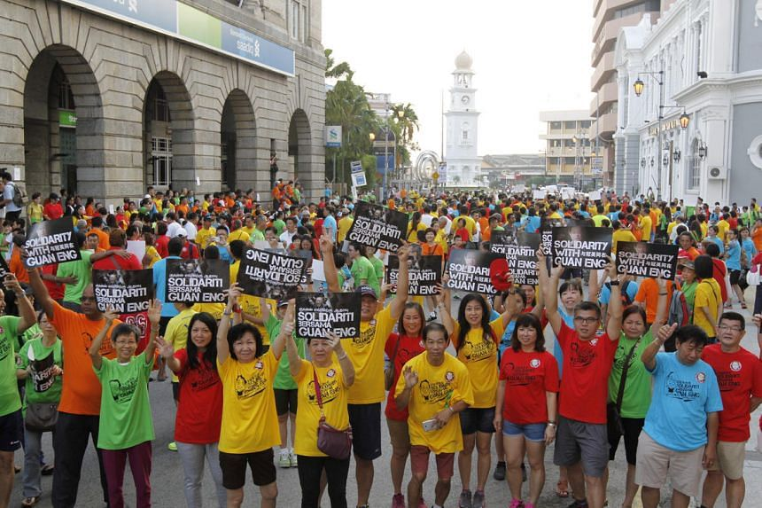 A crowd wearing red, blue, green and yellow T-shirts joined Penang Chief Minister Lim Guan Eng in a solidarity march on July 3, 2016.