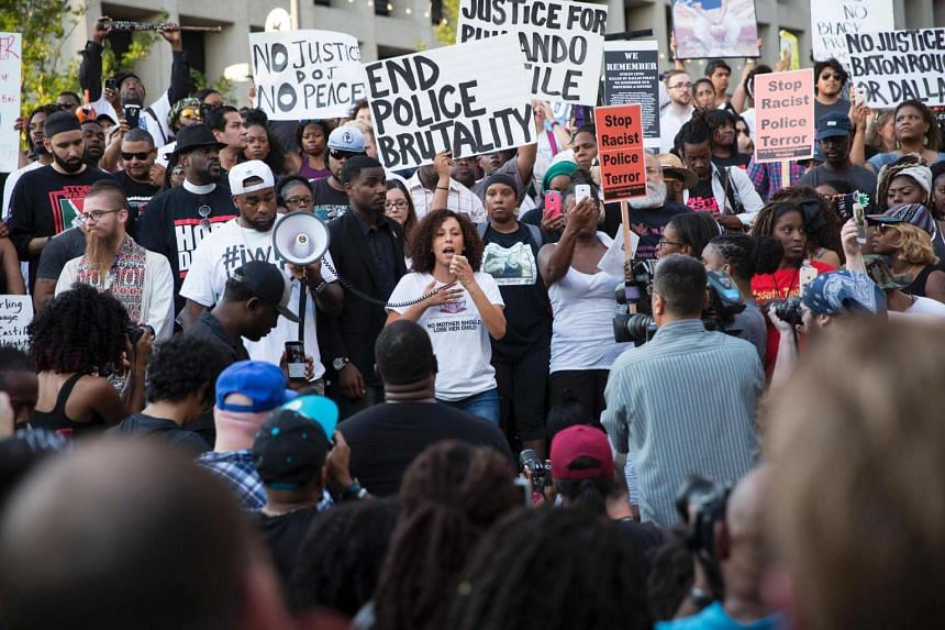 People rally in Dallas, Texas, on July 7 to protest the deaths of Alton Sterling and Philando Castile.