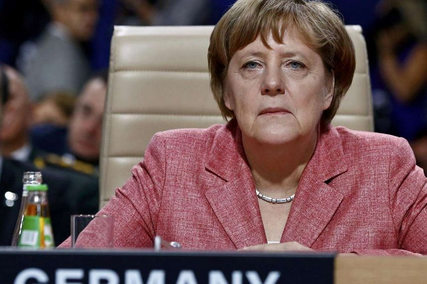 Germany's Chancellor Angela Merkel attends a working session at the NATO Summit in Warsaw, Poland, July 9.