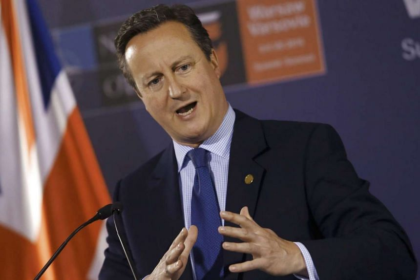 British Prime Minister David Cameron speaks at a news conference in Warsaw, Poland, on July 9, 2016.