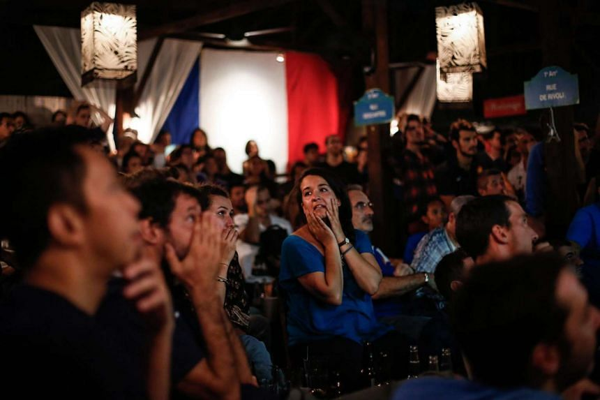 French supporters react during the Uefa Euro 2016 final match between Portugal and France.