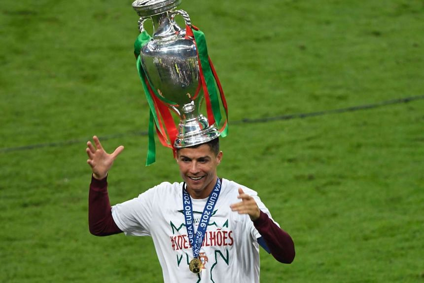 Said to carry the Portugal national team on his shoulders, Cristiano Ronaldo proves he can balance the Euro 2016 trophy on his head too.