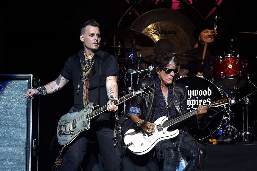 Guitarist Joe Perry (right) performing with Johnny Depp at the Ford Ampitheater at Coney Island Boardwalk, in Brooklyn, on July 10, 2016.