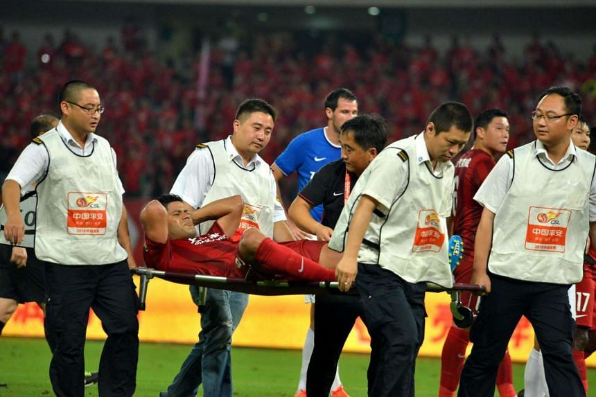 Shanghai SIPG's Hulk being carried off the pitch on a stretcher after an injury during the 16th round football match in Shanghai.