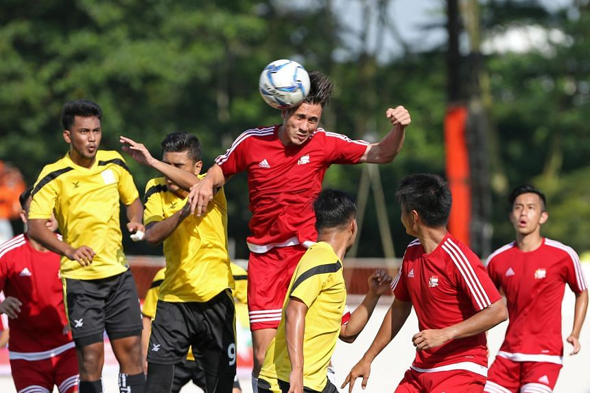 Singapore's forward Anders Aplin, takes a header in the group stage of the 18th Asean University Games football match on July 11, 2016.
