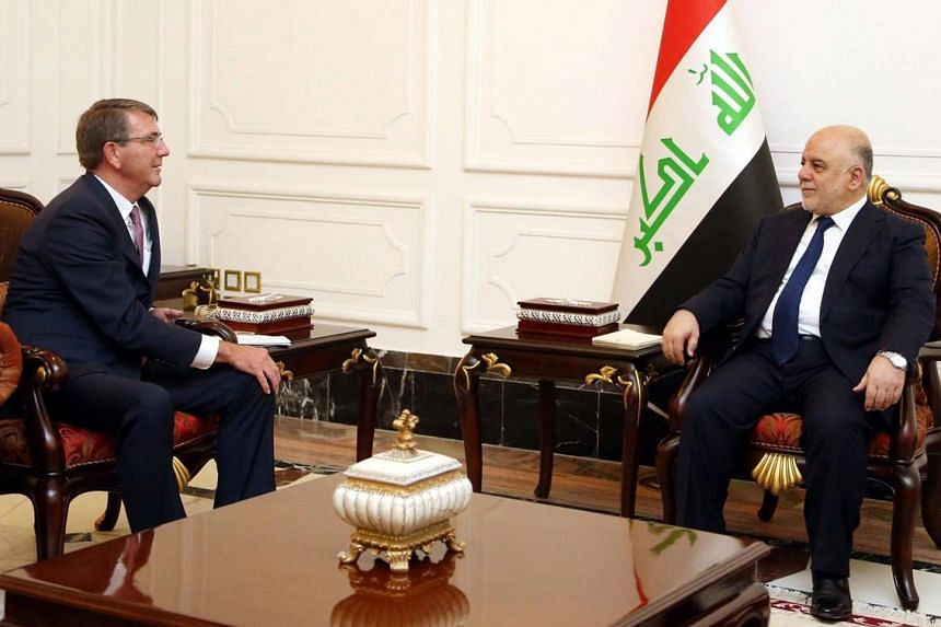 Iraqi Prime Minister Haider al-Abadi (right) meets with US Defence Secretary Ashton Carter in Baghdad, Iraq, on July 11, 2016.