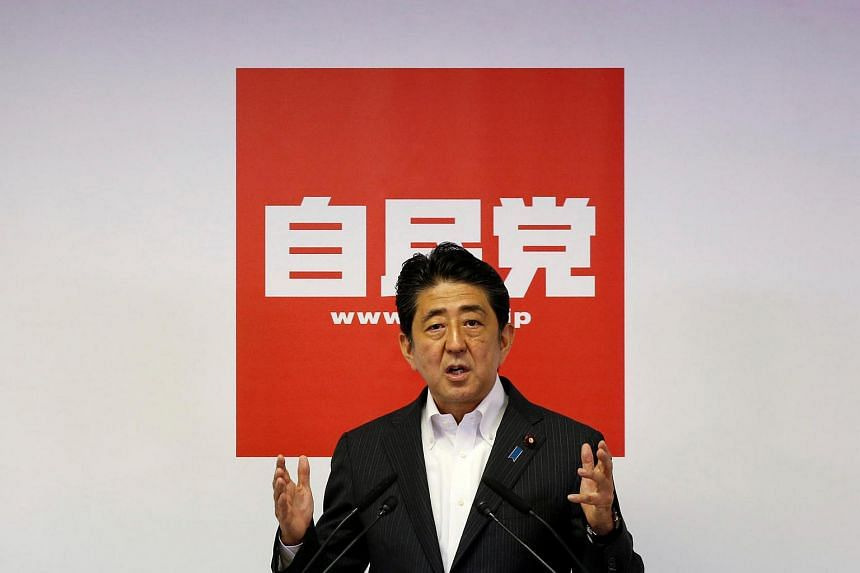 Japan's PM and leader of the ruling Liberal Democratic Party Shinzo Abe attends a news conference following a victory in the upper house elections by his ruling coalition, at the LDP headquarters in Tokyo, Japan, July 11.