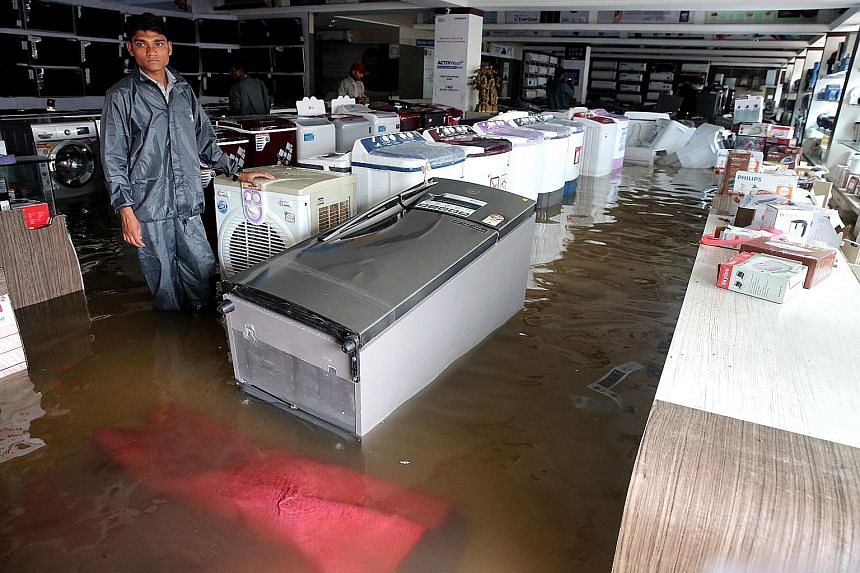 An electronic appliances shop in Bhopal, Madhya Pradesh, flooded after heavy rains on Saturday. The state had also been among the worst drought-affected areas in India.