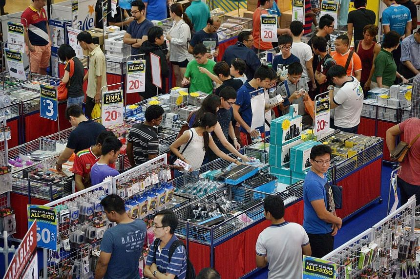 Singapore's many sales could benefit the economy by increasing production and in turn increasing employment, but excessive consumerism also puts a strain on the planet's natural resources.