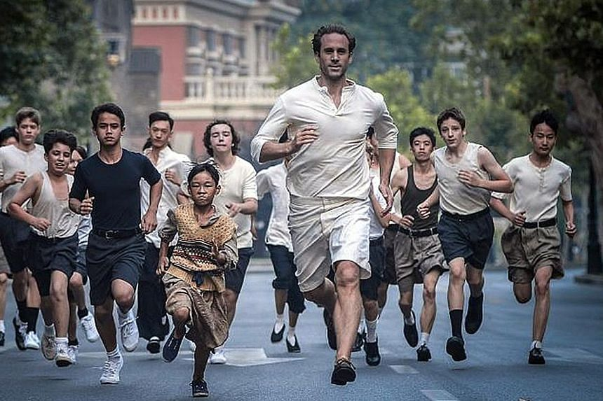 Joseph Fiennes (centre) plays Olympian Eric Liddell in The Last Race, which focuses on his last years in China.