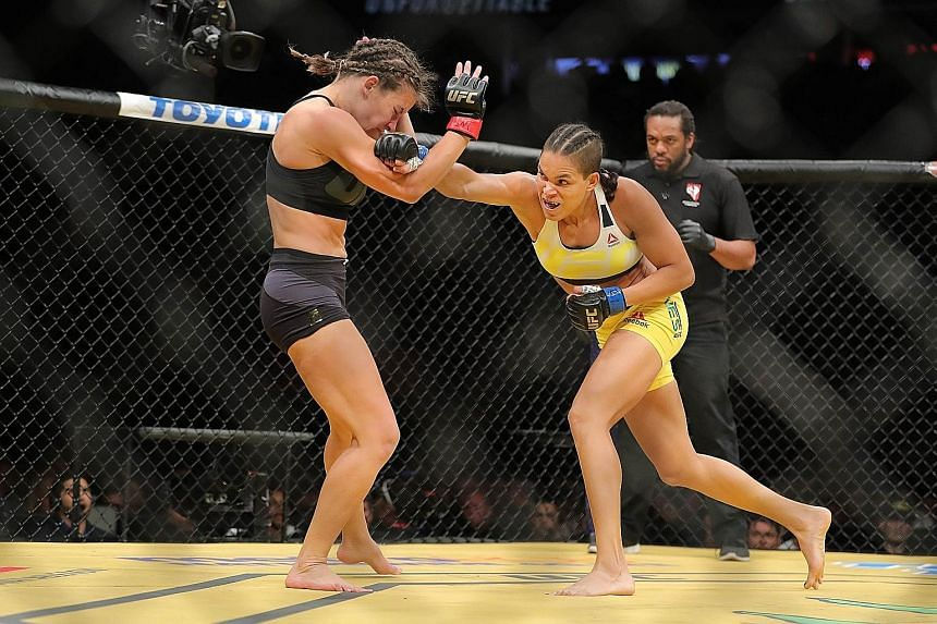 Amanda Nunes landing a punch on American Miesha Tate during their bantamweight bout at UFC200. The Brazilian was quick out of the blocks, taking just over three minutes to subdue her opponent and claim the title.