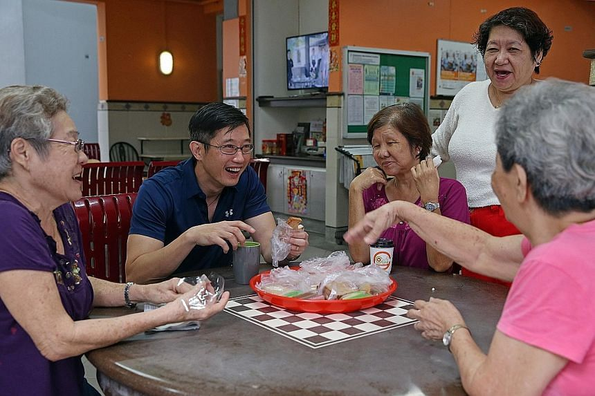 Mr Teo interacting with residents at Compassvale Lodge RC Cafe. Mr Teo, who is Minister of State for Manpower and Mayor of North East District, said that on top of their role as MPs, mayors also had to think of solutions to prevent problems before th