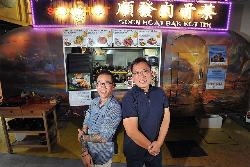 Mr Wu, (in dark blue shirt) and Mr Yeow at the Soon Huat Bak Kut Teh stall at Timbre+. The two teamed up with social entrepreneur Jabez Tan to pilot a project that will help marginalised groups in society, such as former offenders.