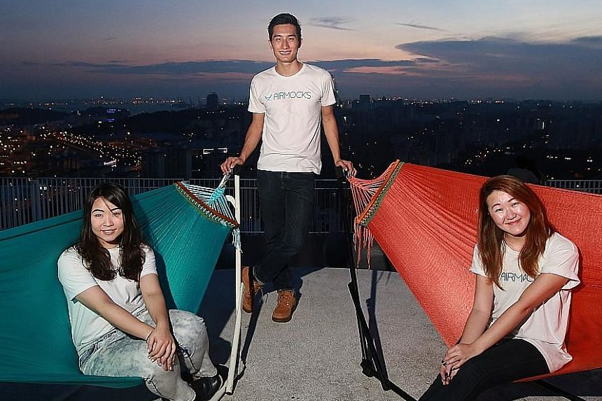 "Mr Ernest Ng, founder of hammock company Airmocks, with former ""externs"" Huang Hui Si (left), 24, and Toh Siew Ting, 22, both of whom are NTU students. ""Each extern whom I worked with brought in a new perspective,"" said Mr Ng."