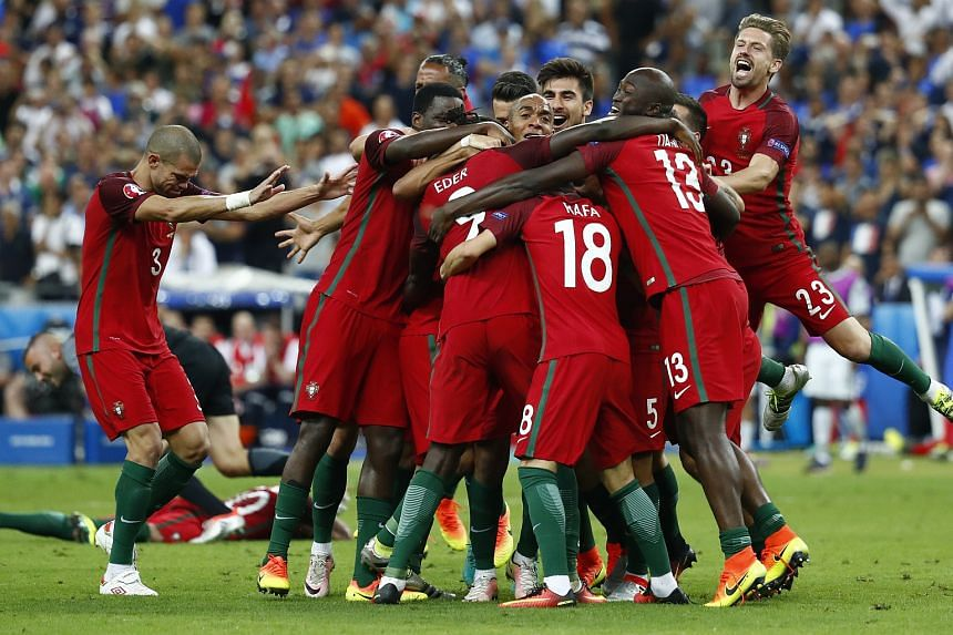 Portugal's Eder, Pepe and teammates celebrate after winning Euro 2016.