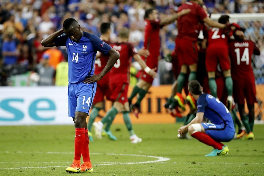Players react after Portugal won the Uefa Euro 2016 final match between Portugal and France at Stade de France in Saint-Denis, France, on July 10.