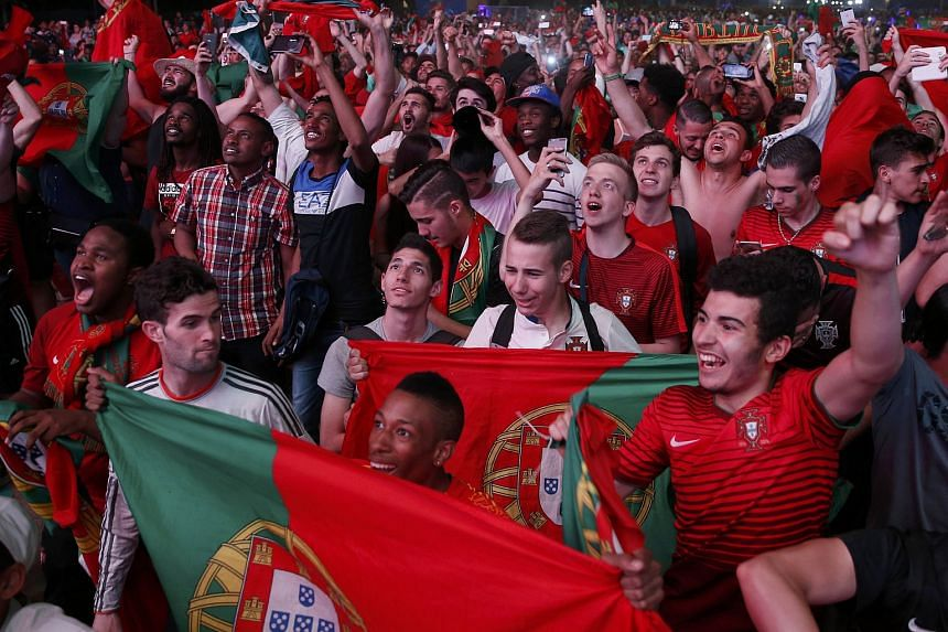 Portugal fans react at the fan zone after their team won in the Portugal v France Euro 2016 final soccer match in Paris, France, July 10.