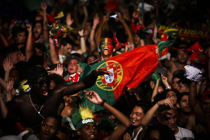 Supporters of Portugal celebrate their team's victory at the end of the public viewing of the Uefa Euro 2016 final match between Portugal and France.
