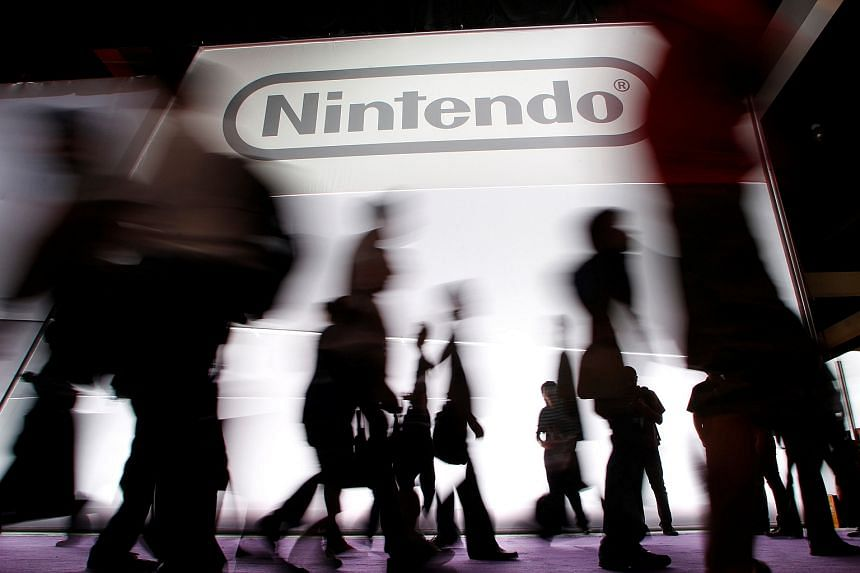 Attendees walk past the Nintendo booth during the Electronic Entertainment Expo in Los Angeles in 2011.