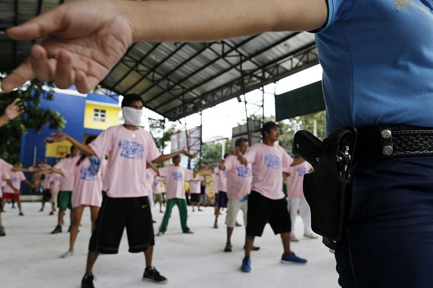 Filipinos allegedly involved in illegal drugs, participate in a Zumba dance class during a detoxification program.