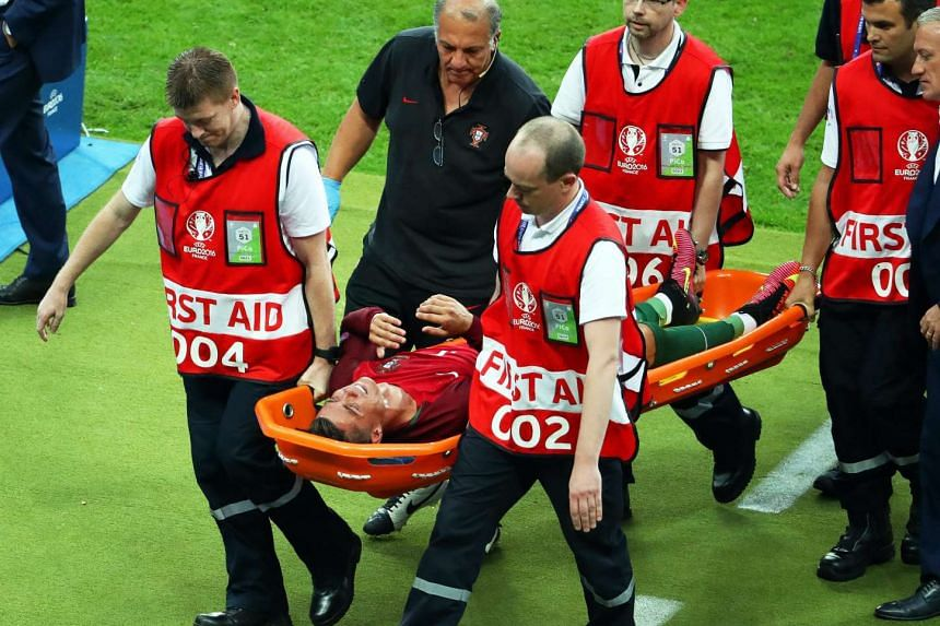 Cristiano Ronaldo is stretchered off the pitch after being injured during the Euro 2016 Final.