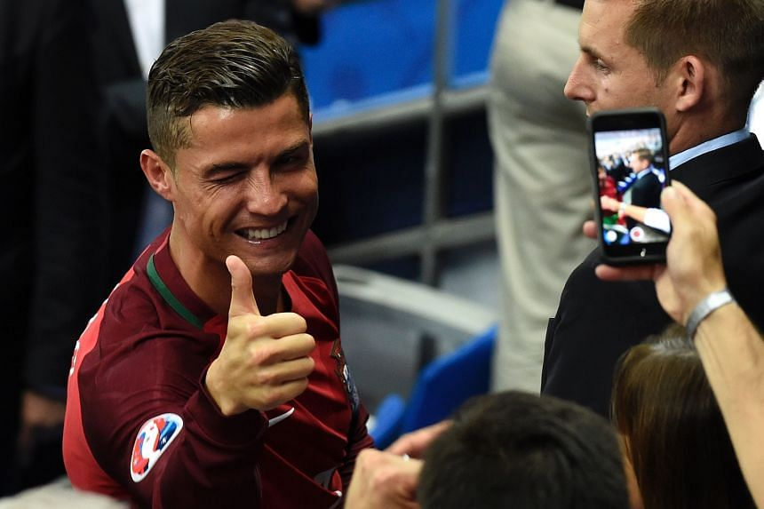 Cristiano Ronaldo gives a thumbs up after the Euro 2016 final football match between Portugal and France at the Stade de France.