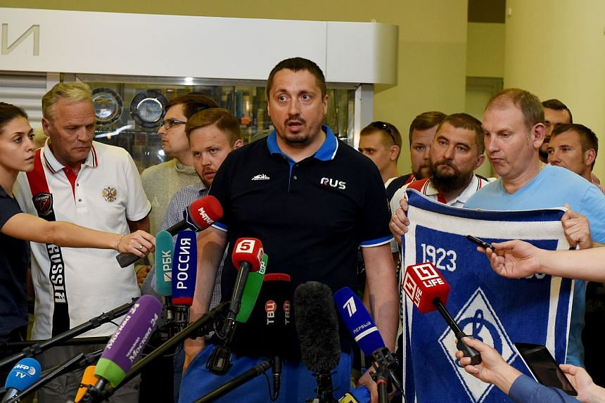 This file photo taken on June 18 shows Russia's football fans leader Alexander Shprygin (center) answering journalists questions at the international airport Sheremetevo near Moscow after being expulsed from France after violent clashes with England